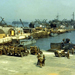US Jeeps loaded onto LCTs; trucks and DUKWs loaded onto LSTs, England, Jun 1944