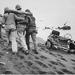Navy corpsmen helped a wounded Marine to reach an aid station, Iwo Jima, 1945